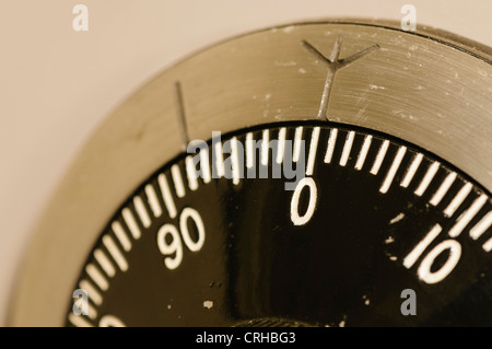 Closeup of a combination lock on a military-grade secure safe with the dial set to 0 - Stock Photo