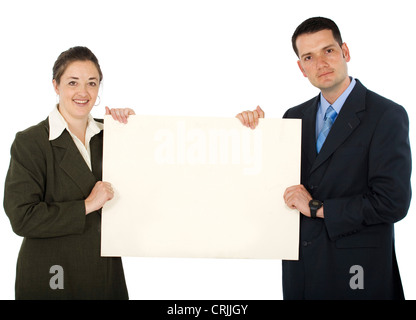 two young business people holding up a sign - Stock Photo