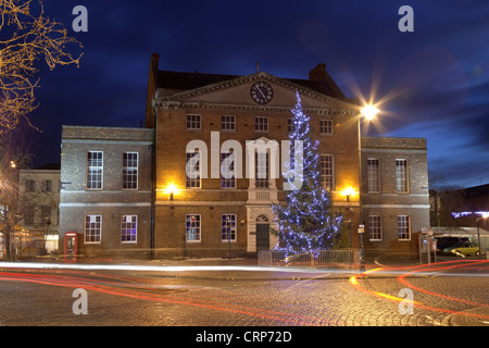 A large Christmas tree decorated with lights in front of the Market House in Taunton town centre. - Stock Photo