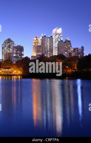 Skyline and reflections of midtown Atlanta, Georgia in Lake Meer from Piedmont Park. - Stock Photo