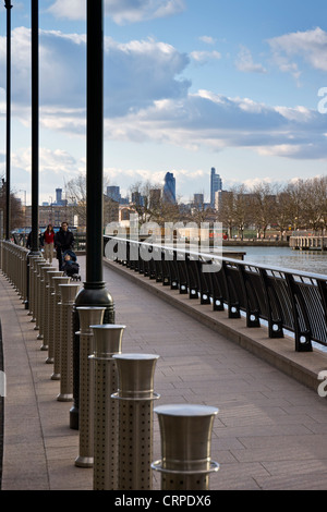 City of London skyscrapers in the distance, viewed from Docklands in the East End of London. - Stock Photo