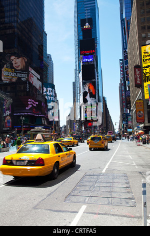 The iconic yellow taxi cab in Times Square, New York city USA. Times square new York,times square,times square new - Stock Photo