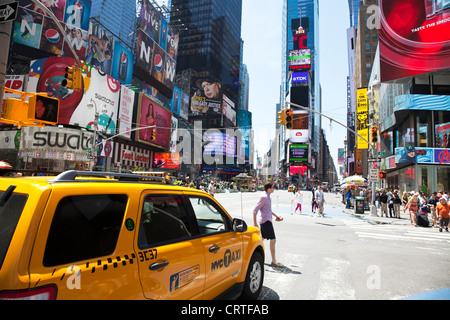 The iconic yellow taxi cab in Times Square, New York city USA.,Times square new York,times square,times square new - Stock Photo