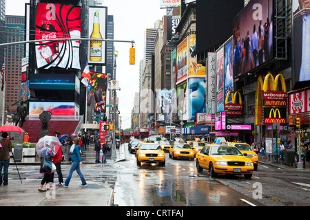 The iconic yellow taxi cab in Times Square, New York city USA. buildings modern cities,Times square new York,times - Stock Photo