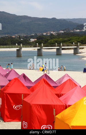 Colourful tents for changing on the beach , Vila Praia de Ancora , near Caminha, Minho Province, northern Portugal - Stock Photo