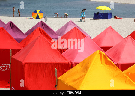 Colourful tents for changing on the beach , Vila Praia de Ancora , near Caminha, northern Portugal - Stock Photo