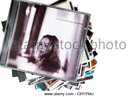 Tori Amos 1999 album, To Venus and Back, piled music CD cases, England. - Stock Photo