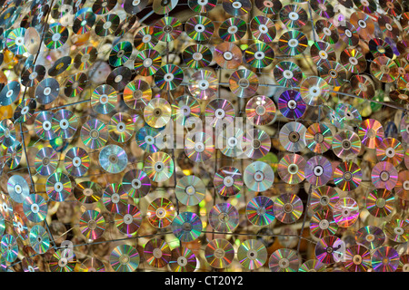 background of many compact disk hanging on metallic structure - Stock Photo