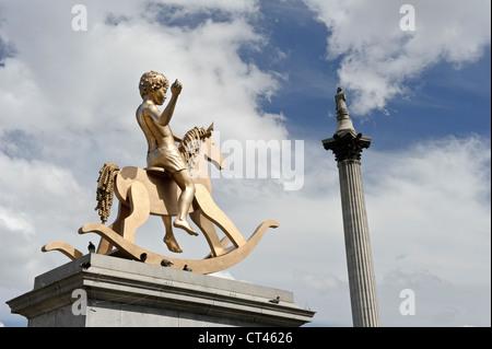 'Boy on rocking horse', Trafalgar Square, London, England, UK. - Stock Photo