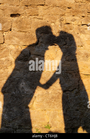 Kissing couple's shadows - Stock Photo