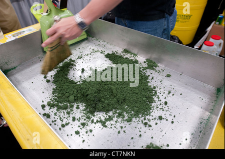 Hazardous materials absorbent 'Green Stuff' is used on sample oil and antifreeze at an environmental quality trade - Stock Photo