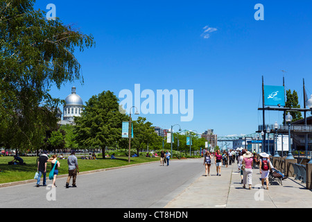 Riverfront promenade in the Quais du Vieux Port area with dome of the Bonsecours Market to the left, Montreal, Quebec, - Stock Photo