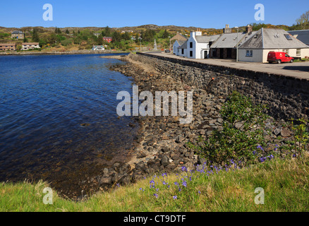 Village waterfront by Loch Inver on north west Highlands coast Lochinver, Assynt, Sutherland, Scotland, UK, Britain - Stock Photo