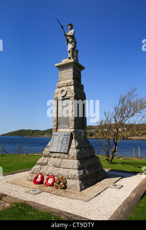 War memorial sculpture on the waterfront in northwest Scottish village of Lochinver, Assynt, Sutherland, Scotland, - Stock Photo