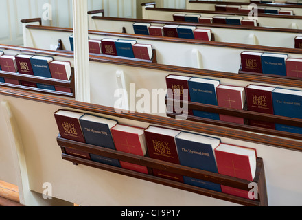 Pews with prayerbooks and hymnals. - Stock Photo