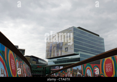 Westfield shopping centre Stratford City displaying Olympic messages and images  on bridge London Olympics Britain - Stock Photo