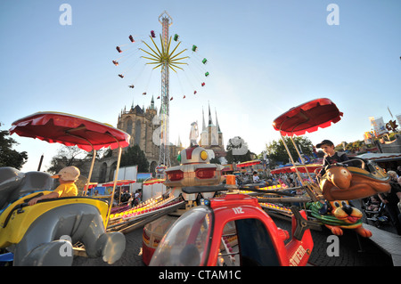 Funfair and amusement rides on Cathedral square, Erfurt, Thuringia, Germany - Stock Photo
