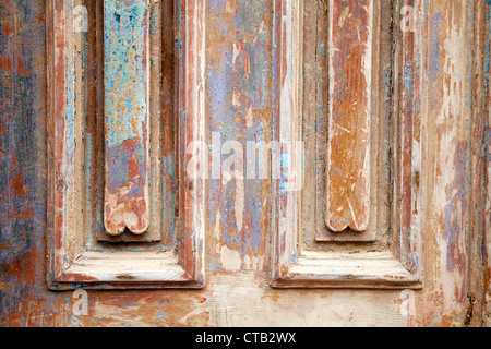 Colourful peeling paint on an old wooden door, Essaouira, Morocco, Africa - Stock Photo