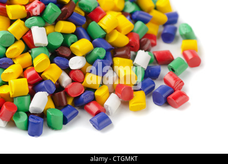Colourful plastic polymer granules on white - Stock Photo