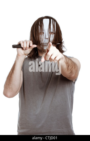 Scary masked killer with knife, pointing at you, isolated on white background. - Stock Photo