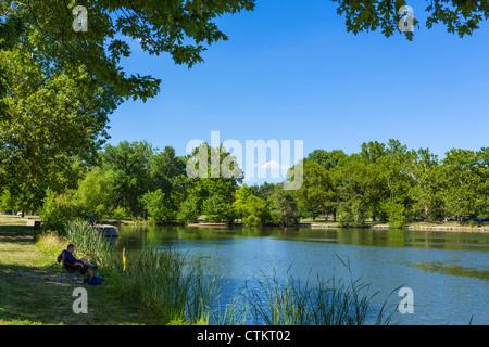 Fishing on Jefferson Lake in Forest Park, St Louis, Missouri, USA - Stock Photo