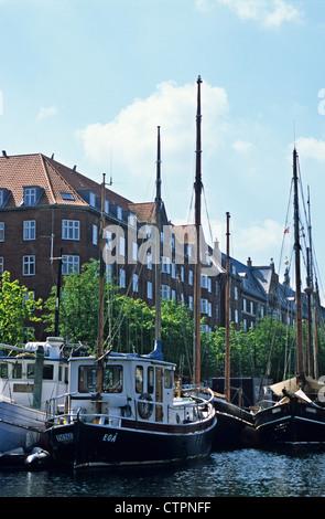 Boats in Christianhavn canal, Copenhagen, Denmark - Stock Photo