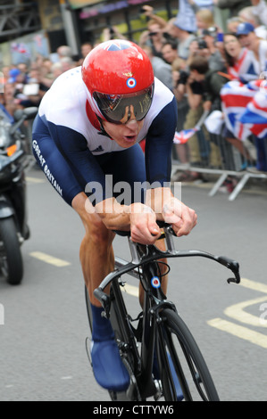 Bradley Wiggins (Team GB) on the way to winning a gold medal in the 2012 Olympic Men's Individual Cycling Time-Trial, - Stock Photo