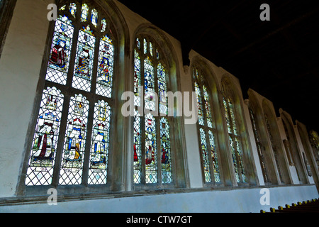 Row of Stained Glass Windows in Holy Trinity Church, Long Melford, Suffolk - Stock Photo