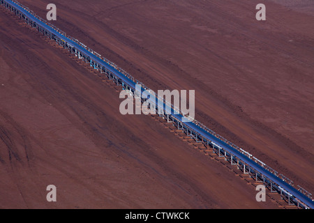 Brown coal / lignite being transported on conveyor belt at open-pit mine, Saxony-Anhalt, Germany - Stock Photo