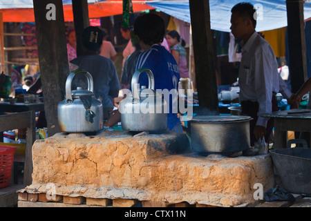 TEA being prepared at the weekly market at MAING THAUK - INLE LAKE, MYANMAR - Stock Photo