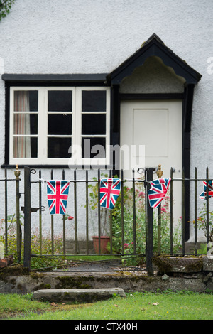 Union Jack bunting on a cottage gate. Pembridge. Herefordshire. England - Stock Photo