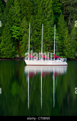 Three masted sailing vessel at anchor in a sheltered inlet, Vancouver Island, Canada - Stock Photo