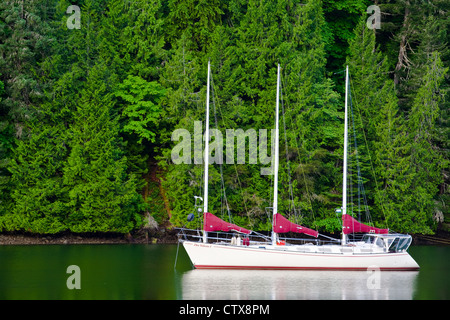 Three masted sailing vessel at anchor in a sheltered inlet, Vancouver Island, British Columbia, Canada - Stock Photo