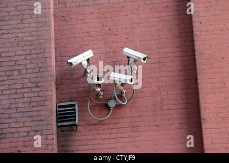 A battery of surveillance cameras is seen guarding a Chelsea building on January 29, 2004. (© Frances M. Roberts) - Stock Photo