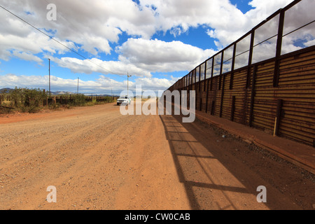 The border fence between the United States and Mexico at Naco, Arizona. - Stock Photo
