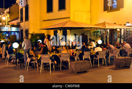 Portugal - Madeira - Funchal Zona Velha - late evening in the old town - busy open air restaurant - atmospheric - Stock Photo