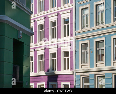 Parts of old apartment blocks in central Oslo Norway painted in a colourful manner - Stock Photo