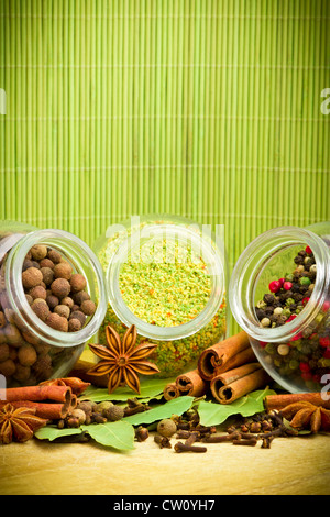 Pack of several spices and herbs in glass jars - Stock Photo