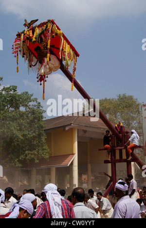 Garudan Thookkam ritual offering of devotees in Sri Sarkara Devi Temple Kerala India.Rituals Kite Swinging or Eagle - Stock Photo