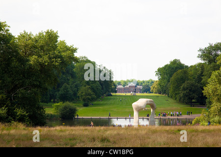Kensington Palace with Henry Moore's sculpture 'The Arch' in the foreground, London, UK - Stock Photo