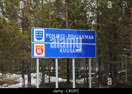 road sign in the coniferous forest of the finnish taiga, Finland - Stock Photo