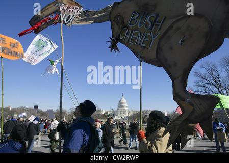 Protesters walk with a large dinosaur shaped sign during a large anti war rally leading up to the Iraq war on the - Stock Photo
