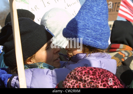 A mother pictured with her daughter during a large anti war rally leading up to the Iraq war on the National Mall - Stock Photo