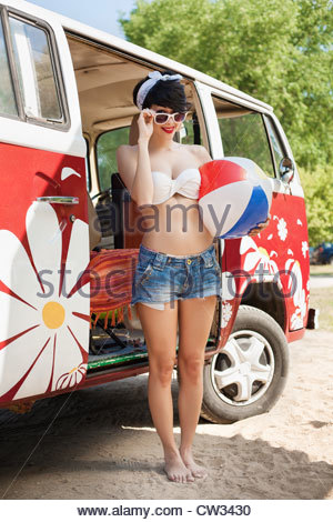 Young caucasian woman with beach ball - Stock Photo