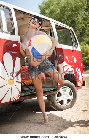 Young woman dancing with beach ball - Stock Photo