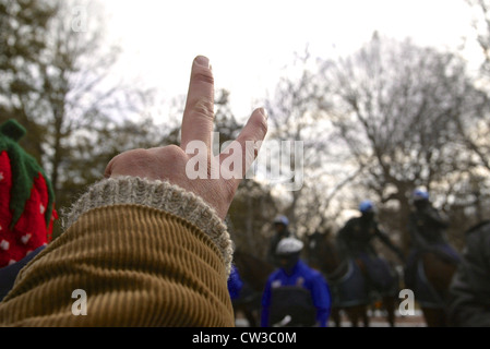 A man holds up a peace sign near the White House during a large anti war rally leading up to the Iraq war in Washington - Stock Photo