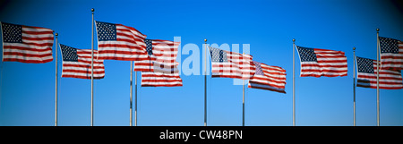 Row of American flags blowing in wind - Stock Photo
