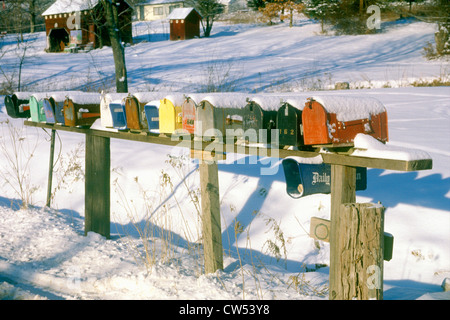 Row of residential mailboxes in rural, winter setting,  Woodstock, NY - Stock Photo