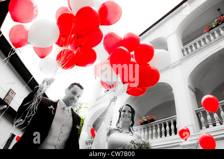 bridal couple with red balloons - Stock Photo