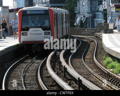 Train in Hamburg is driving over winding tracks into the direction of Berliner Tor, Germany, Hamburg - Stock Photo